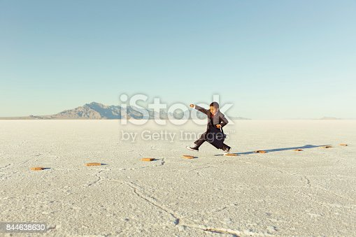 844638658 istock photo Young Business Boy On Stepping Stones 844638630