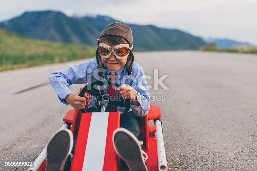 959599892 istock photo Young Business Boy Races Go Cart 959599902