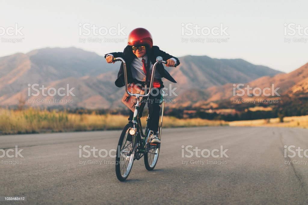 Young Business Boy Racing on Bicycle stock photo