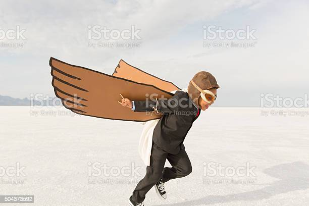 Young business boy running with cardboard wings picture id504373592?b=1&k=6&m=504373592&s=612x612&h=t t2q4nk5qqftjl9sdhnzpoeqxgalbeteobcxazgywi=