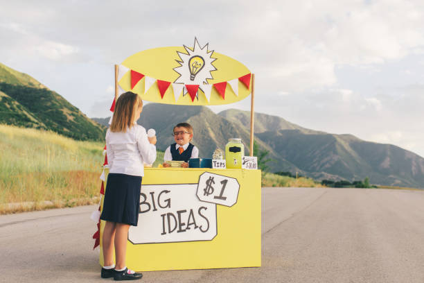 Young Business Boy Sells Big Ideas to Young Business Girl stock photo