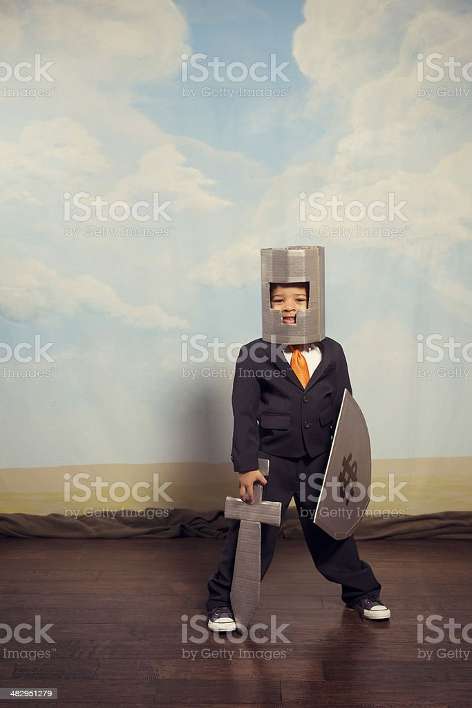 Young Business Boy Wearing Cardboard Armor stock photo