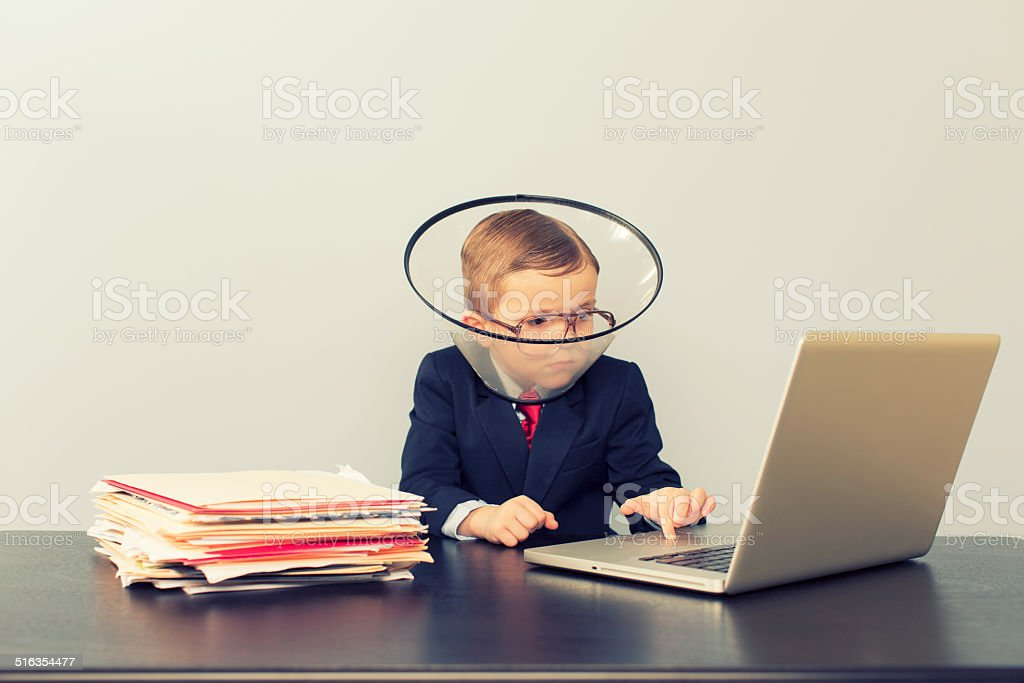 Young Business Boy Wearing Dog Collar stock photo