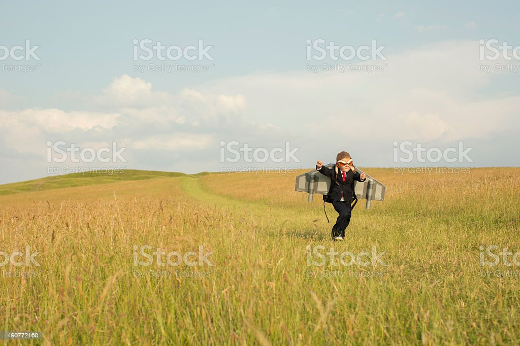 Young Business Boy Wearing Jetpack in England stock photo