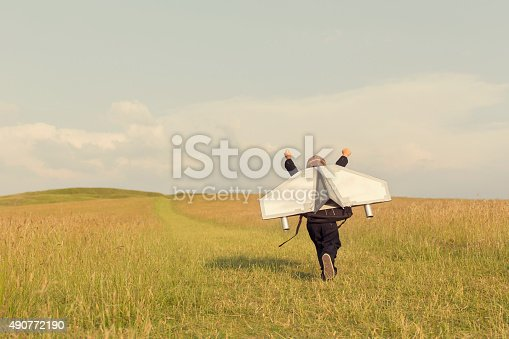 istock Young Business Boy Wearing Jetpack in England 490772190