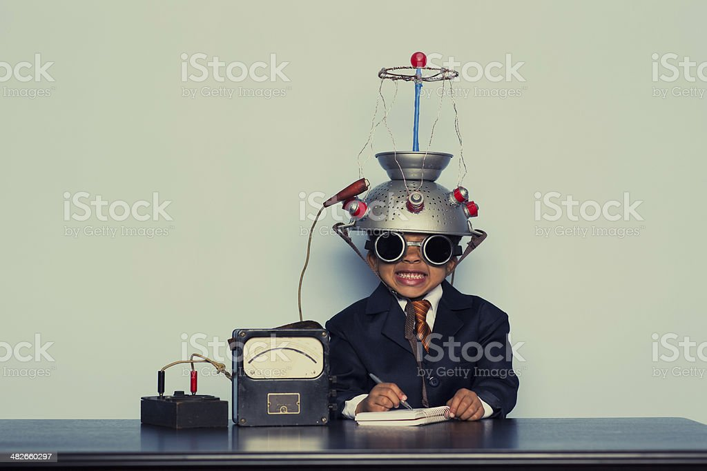 Young Business Boy Wearing Mind Reading Helmet stock photo