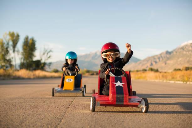 Young Business Boy Winning Car Race stock photo
