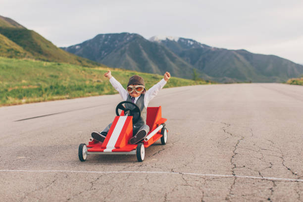 young business boy wins go cart race - finishing stock photos and pictures