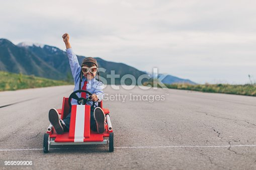 959599892 istock photo Young Business Boy Wins Go Cart Race 959599906