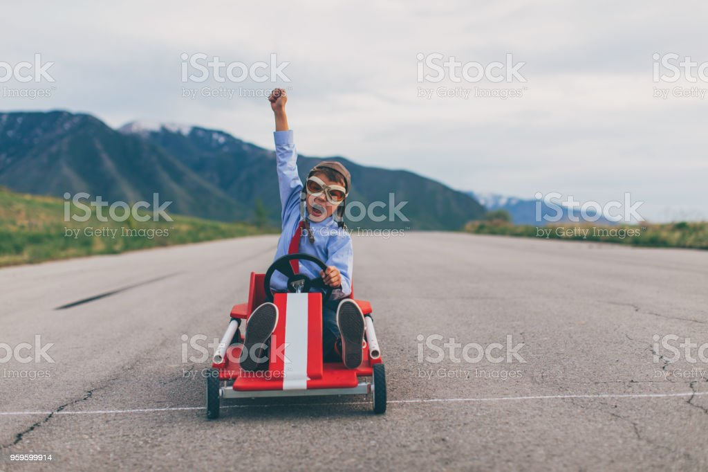 Young Business Boy Wins Go Cart Race stock photo