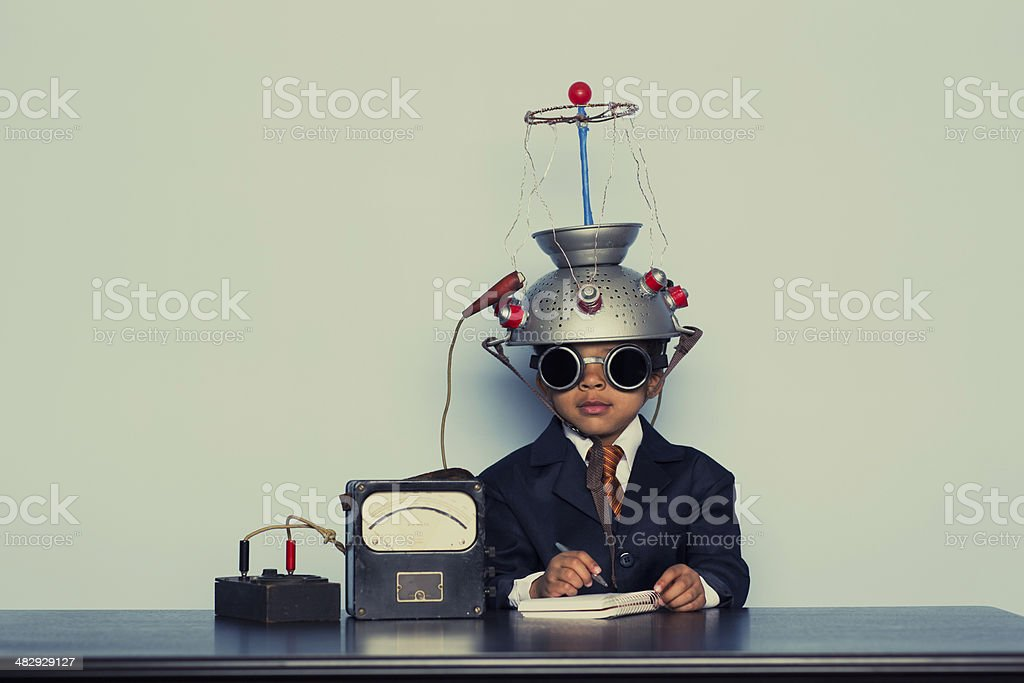 Young Business Boy with Mind Reading Helmet stock photo