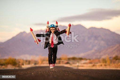 istock Young Business Boy with Rocket Helmet 995808282