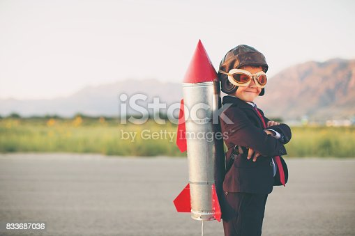istock Young Business Boy with Rocket on Back 833687036