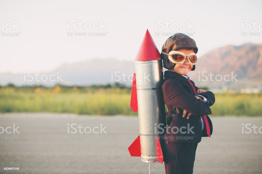 Young Business Boy with Rocket on Back - foto stock