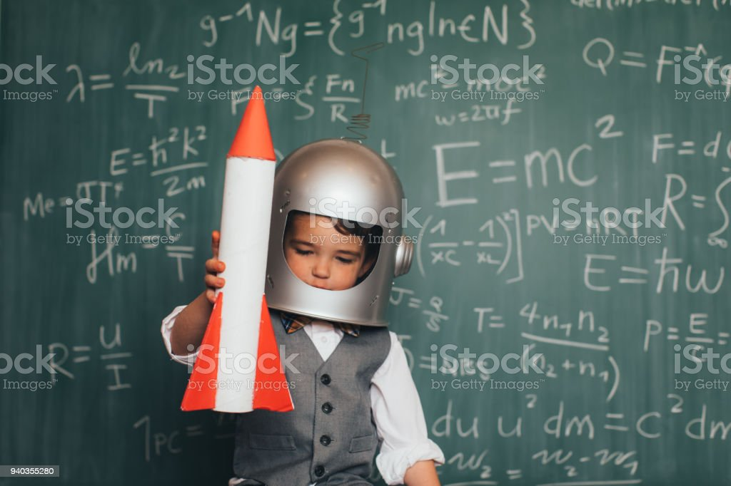Young Business Boy with Space Helmet and Rocket stock photo