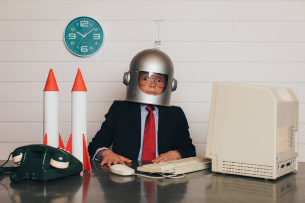 Young Business Boy with Space Helmet and Rockets stock photo