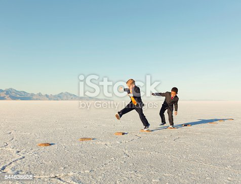 istock Young Business Boys and Team On Stepping Stones 844638658