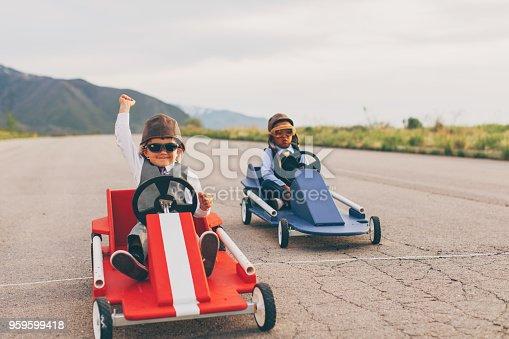 959599892 istock photo Young Business Boys Go Cart Racing 959599418