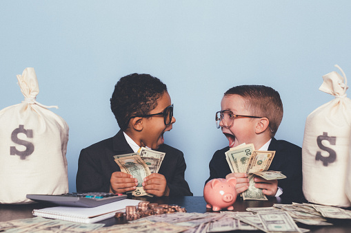 A business team of young boys have figured out the perfect business model and are swimming in success. Making loads of money for your business requires hard work, teamwork, and a little luck.
