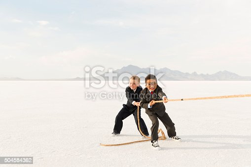 istock Young Business Boys Pulling a Tug of War Rope 504584362