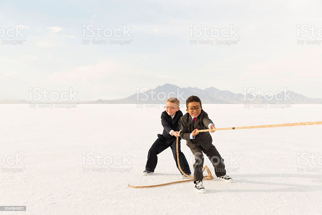 Young Business Boys Pulling a Tug of War Rope stock photo