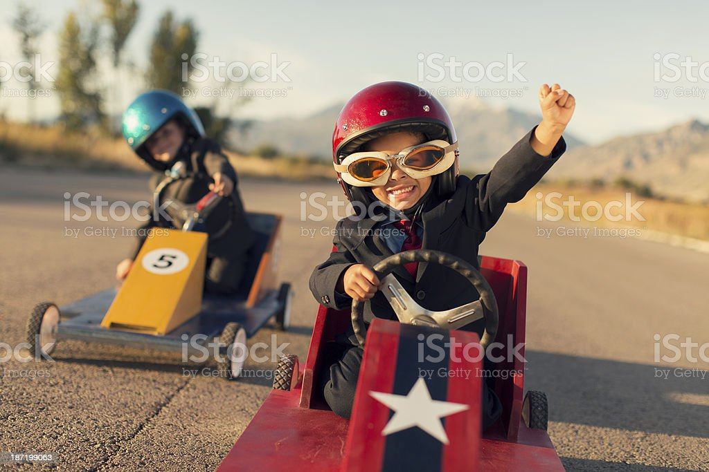 Young Business Boys Race Toy Cars stock photo