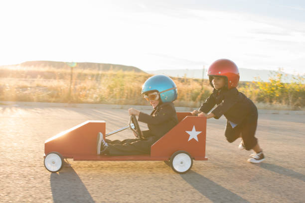 Young Business Boys Racing a Toy Car