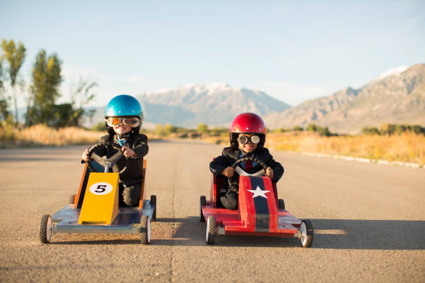 Young Business Boys Racing Toy Cars stock photo