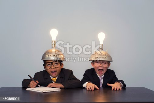 480585411 istock photo Young Business Boys Wearing Business Suits and Thinking Caps 480585921