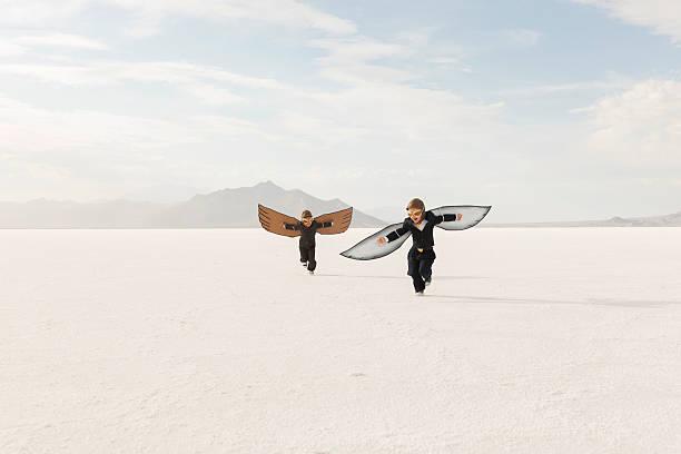 Young business boys wearing cardboard wings are flying picture id503955600?b=1&k=6&m=503955600&s=612x612&w=0&h=vlfajpdzynl3dfupkmwt00hsyu ghtlvhxc5awfm57m=