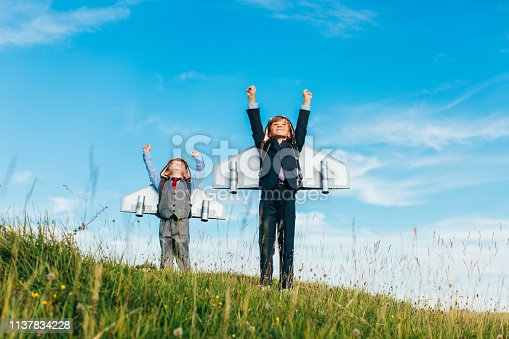 istock Young Business Boys Wearing Jetpacks 1137834228