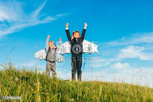 844638658 istock photo Young Business Boys Wearing Jetpacks 1137834263