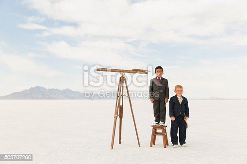 istock Young Business Boys with Telescopes 503707260