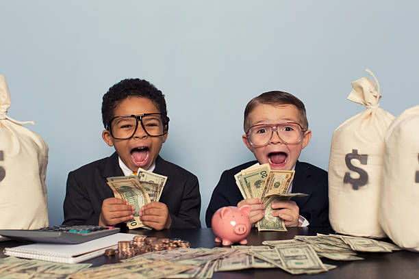 Young Business Children Make Faces Holding Lots of Money stock photo