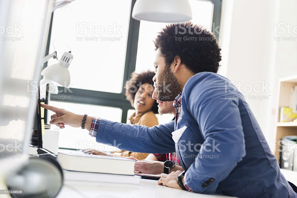 Young Business Colleagues In Bright Office royalty-free stock photo