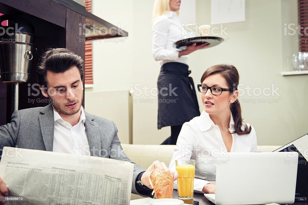 young business couple in a cafe royalty-free stock photo