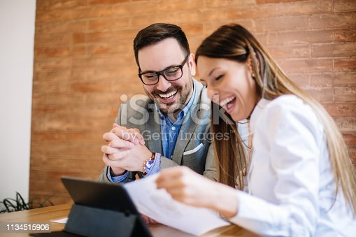 istock Young business couple signing a contract 1134515906