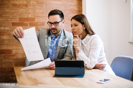 istock Young business couple signing a contract 1134516518