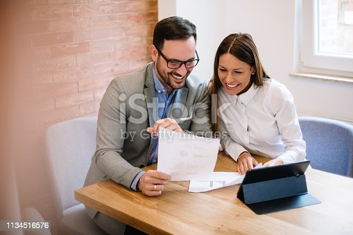 istock Young business couple signing a contract 1134516576