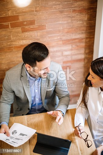 istock Young business couple signing a contract 1134516601