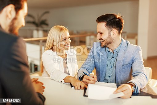 istock Young business couple signing a contract 656184262
