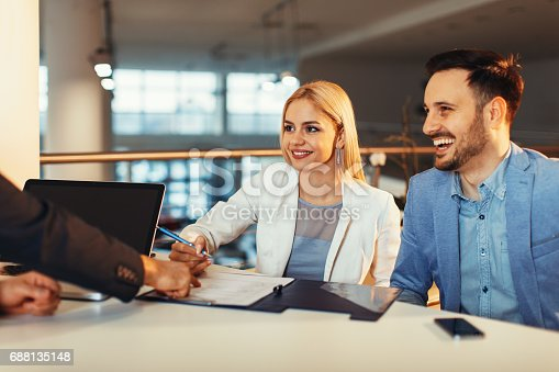 istock Young business couple signing a contract 688135148