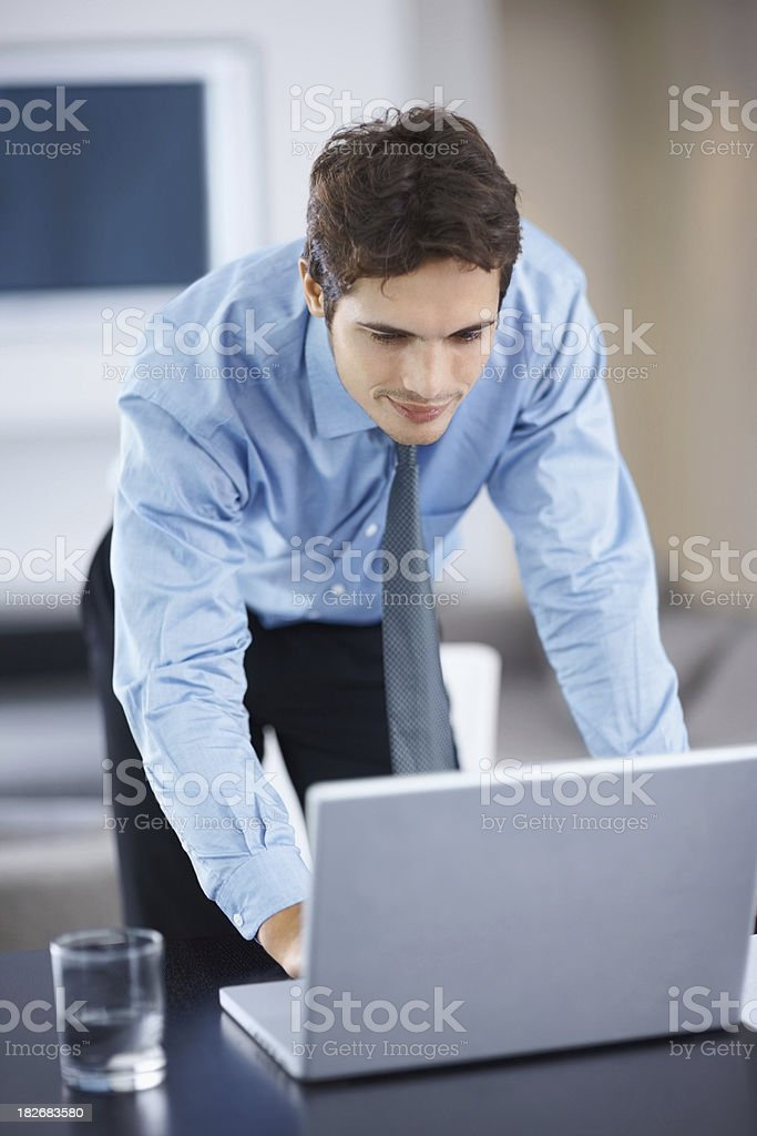 Young business entrepreneur working on the laptop royalty-free stock photo