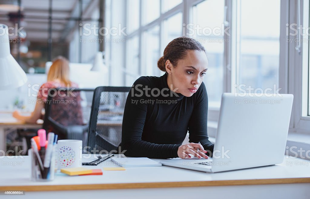Young business executive using laptop stock photo