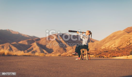 istock Young Business Girl Looks through Telescope 864707760