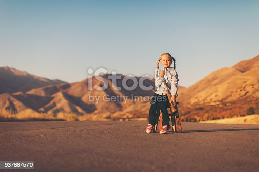 istock Young Business Girl Looks through Telescope 937887570