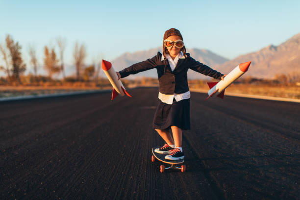 young business girl riding skateboard with rockets - daredevil stock pictures, royalty-free photos & images