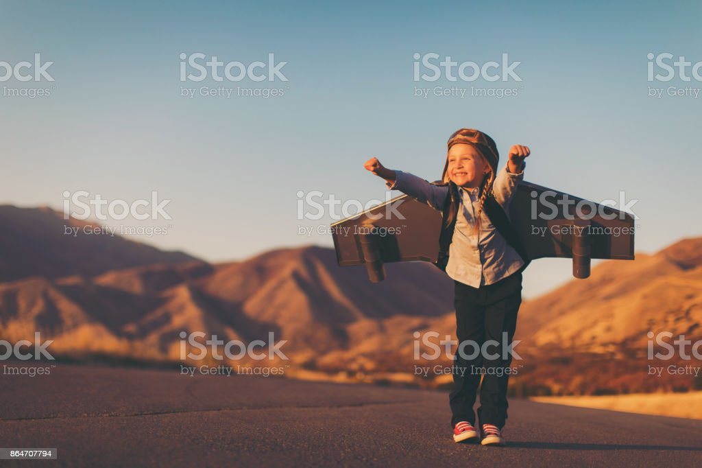 Young Business Girl with Jet Pack Imagines Flying stock photo