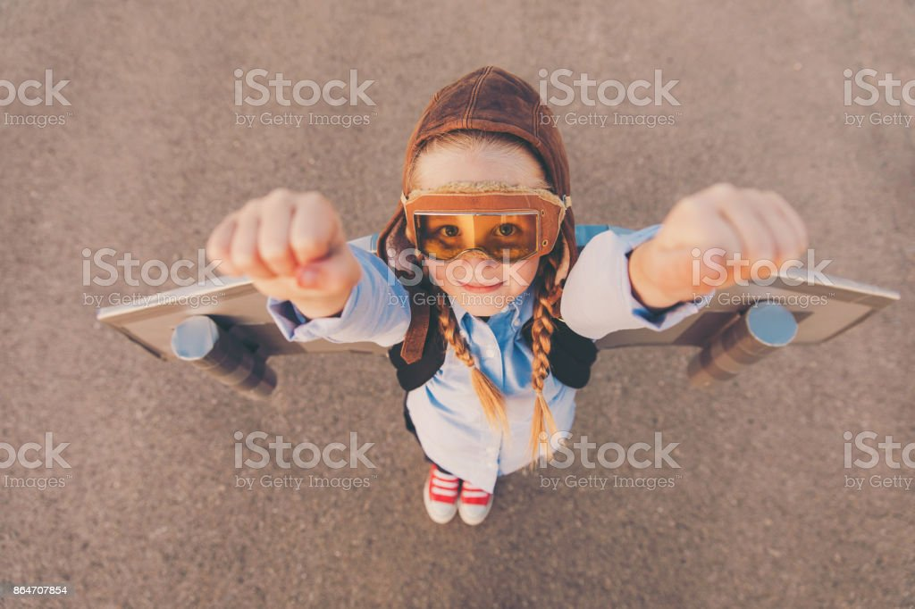 Young Business Girl with Jet Pack Raises Arms stock photo
