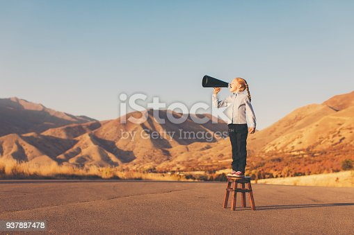 istock Young Business Girl with Megaphone 937887478